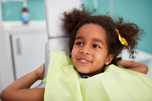 Adorable Black girl getting a dental cleaning at South Austin Dental in Austin, TX